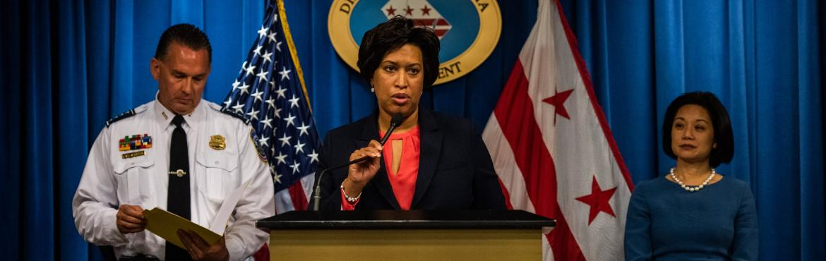 Mayor Muriel Bowser, center, along with United States Attorney for the District of Columbia Jessie K. Liu, right, and D.C Police Chief Peter Newsham, speaks during a press conference .