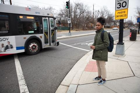 India waits to cross an intersection on her walk home from Kelly Miller Middle School in late January. After receiving so many tardies at Hardy, Vanessa decided to switch India into a middle school closer to their home. Photo by Lydia Thompson/Urban Institute.